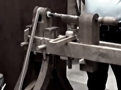 An antique lathe in operation
